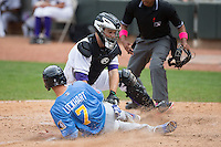 Daniel Lockhart (7) of the Myrtle Beach Pelicans is tagged out trying to score by Winston-Salem Dash catcher Jeremy Dowdy (21) at BB&T Ballpark on May 10, 2015 in Winston-Salem, North Carolina.  The Pelicans defeated the Dash 4-3.  (Brian Westerholt/Four Seam Images)
