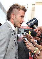 David Beckham talks to the media on the red carpet  prior to the FIFA Final Draw for the FIFA World Cup 2010 South Africa held at the Cape Town International Convention Centre (CTICC) on December 4, 2009.