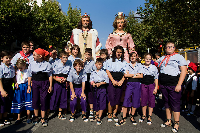 Vilafranca del Pnedes, Barcelona, Catalonia, childrens day, gegantes, 11 years old Laya dances the giant figure of Yolanda from Hungary