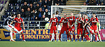 The Rangers wall stands staunch and true as Falkirk try to score another goal