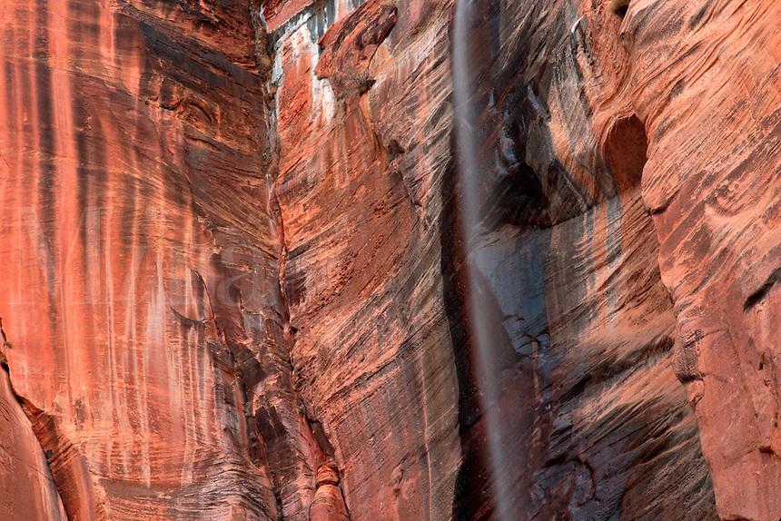 Waterfall running down red stone canyon wall, Zion National Park, Washington County, U