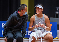 Den Bosch, The Netherlands, April 16, 2021,    Maaspoort, Billy Jean King Cup  Netherlands -  China , seccond Match:  Xiyu Wang (CHN) on the bench with captain Shuo Liu (CHN)<br /> Photo: Tennisimages/Henk Koster