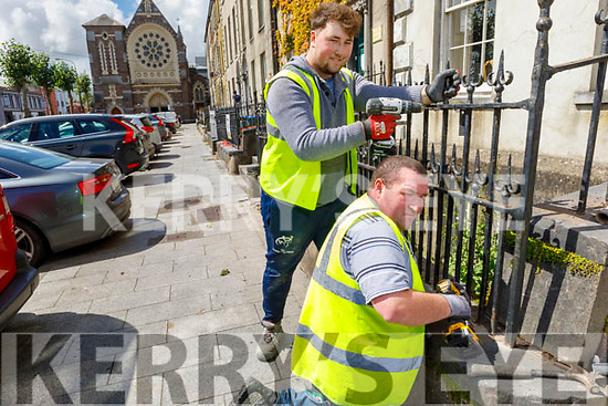 Trevor Cronin and Tyland Supple working on the railings in Day Place on Monday as the Kerry County Council received €160k to restore and replace the railings
