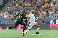 FOXBOROUGH, MA - AUGUST 4: Andrew Farrell #2 of New England Revolution attempts to control the ball as Adama Diomande #99 of Los Angeles FC defends during a game between Los Angeles FC and New England Revolution at Gillette Stadium on August 3, 2019 in Foxborough, Massachusetts.
