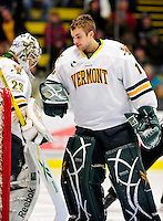9 January 2011: University of Vermont Catamount goaltender John Vazzano, a Junior from Trumbull, CT, gives Rob Madore a good luck tap prior to a game against the Boston University Terriers at Gutterson Fieldhouse in Burlington, Vermont. The Catamounts fell to the Terriers 4-2 in Hockey East play. Mandatory Credit: Ed Wolfstein Photo