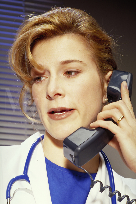 woman Doctor talking on the telephone. portrait, occupations. Barbara Gehring. Boulder Colorado.