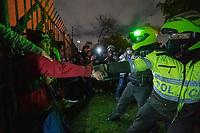 BOGOTA - COLOMBIA, 25-05-2021: Miembros del ESMAD (Escuadrón Móvil Antidisturbios de la Policía) tratan de detener a un joven que estaba en las manifestaciones durante los disturbios en el sector de las Américas de la ciudad de Bogotá durante el día 28 del Paro Nacional en Colombia hoy, 25 de mayo de 2021, para protestar contra el gobierno de Ivan Duque además de la precaria situación social y económica que vive Colombia. El paro fue convocado por sindicatos, organizaciones sociales, estudiantes y la oposición. / Members of the ESMAD (Police Anti-Riot Mobile Squad) try to arrest a young man who was in the demonstrations during the riots at Portal Las Americas sector of the city of Bogota during the day 28 of the National strike in Colombia today, May 25, 2021, to protest against the government of Ivan Duque in addition to the precarious social and economic situation that Colombia is experiencing. The strike was called by unions, social organizations, students and the opposition in Colombia. Photo: VizzorImage / Diego Cuevas / Cont