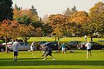 Group of people practicing softball, University of Portland, Oregon
