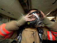 120114-N-DR144-531 ARABIAN SEA (Jan. 14, 2012) Hull Technician Fireman Douglas Anderson dons his self-contained breathing apparatus facepiece during a general quarters drill aboard Nimitz-class aircraft carrier USS Carl Vinson (CVN 70). Carl Vinson and Carrier Air Wing (CVW) 17 are deployed to the U.S. 5th Fleet area of responsibility.  (U.S. Navy photo by Mass Communication Specialist 2nd Class James R. Evans/Released)