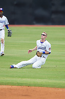 Chattanooga Lookouts right fielder Jeremy Hazelbaker (23) makes a sliding catch during the game against the Montgomery Biscuits at AT&T Field on July 23, 2014 in Chattanooga, Tennessee.  The Lookouts defeated the Biscuits 6-5. (Brian Westerholt/Four Seam Images)