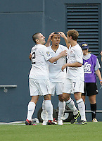 Heath Pearce (2) and Robbie Rogers (7) both pat Charlie Davies (9) on the head after his goal. USA defeated Grenada 4-0 during the First Round of the 2009 CONCACAF Gold Cup at Qwest Field in Seattle, Washington on July 4, 2009.
