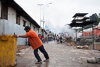 A man cleans the rubbish from the burning ghat at Pashupati Nath temple in Kathmandu, Nepal