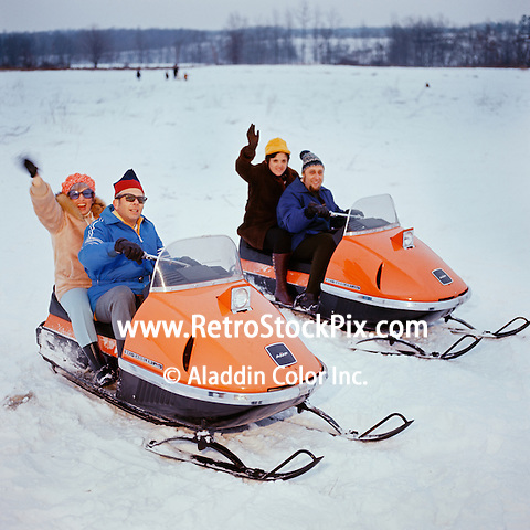 Couples on Snowmobiles - 1969