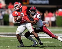 ATHENS, GA - OCTOBER 12: D'Andre Swift #7 of the Georgia Bulldogs is tackled by Israel Mukuamu #24 of the South Carolina Gamecocks during a game between University of South Carolina Gamecocks and University of Georgia Bulldogs at Sanford Stadium on October 12, 2019 in Athens, Georgia.