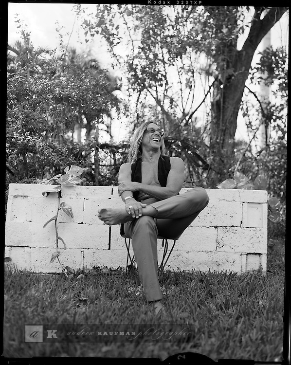 Iggy Pop lives, works and plays in a very non descript home in Miami. It is decorated with plenty of vodoo art, knick nacks and personal momentos. He has a big yard and is on a river. Iggy has a new album coming out with the Stooges. Iggy is an icon to a lot of punk rock bands. His many great songs include I wanna be your dog.