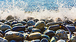 Beach Rocks in surf on beach at Fort Ebey State Park.  Whibey Island, WA.  Boulders and surf.