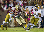 Florida State's Rashad Greene returns a kick off in the first half of an NCAA college football game against Notre Dame in Tallahassee, Fla., Saturday, Oct. 18, 2014.  AP Photo/Mark Wallheiser)