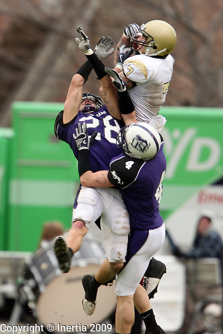 ROME, GA - DECEMBER 19: Matt Bramow #7 of Lindenwood University makes a touchdown catch over Trevor Holleman #28 and  Dan Schmeichel #4 of the University of Sioux Falls during the first half of the NAIA Championship game Saturday afternoon at Barron Stadium in Rome, GA. (Photo by Dave Eggen/Inertia)