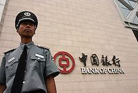 A security guard stands duty at the head-quarter of Bank of China in Beijing, China.