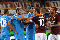Calcio, Serie A: Roma vs Napoli. Roma, stadio Olimpico, 18 ottobre 2013.<br /> AS Roma forward Francesco Totti, back to camera, argues with Napoli midfielder Valon Behrami, of Switzerland, second from left, during the Italian Serie A football match between AS Roma and Napoli at Rome's Olympic stadium, 18 October 2013.<br /> UPDATE IMAGES PRESS/Riccardo De Luca
