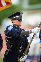 General view of the Nicholasville Police Department presenting the flag for the national anthem before a game between the Hagerstown Suns and Lexington Legends on May 22, 2015 at Whitaker Bank Ballpark in Lexington, Kentucky.  Lexington defeated Hagerstown 5-1.  (Mike Janes/Four Seam Images)