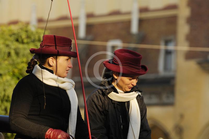 Poland, Krakow, Horse carriage drivers, Rynek Glowny, Grand Square