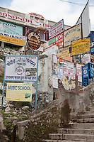 India, Rishikesh.  Assorted Advertisements near the Footbridge over the Ganges (Ganga).