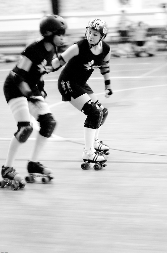 two ladies fight it out while trying to score points at the Richmond Roller Derby