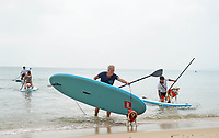 BNPS.co.uk (01202 558833)<br /> Pic: ZacharyCulpin/BNPS<br /> <br /> Putting their best paw forward hoping to ride the wave of success - Competitors and their dogs take part in the annual Dog Surfing championships.<br /> <br /> The event known as The 'dogmasters' took place today on Bournemouth beach in front of packed crowd, it's the country's only dog surfing and paddleboard championship.