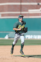 Austin Grebek (22) of the Oregon Ducks returns to the dugout during a game against the Southern California Trojans at Dedeaux Field on April 18, 2015 in Los Angeles, California. Oregon defeated Southern California, 15-4. (Larry Goren/Four Seam Images)