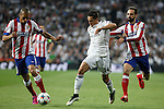 Real Madrid's Chicharito (C) and Atletico del Madrid´s Juanfran and Joao Miranda during quarterfinal second leg Champions League soccer match at Santiago Bernabeu stadium in Madrid, Spain. April 22, 2015. (ALTERPHOTOS/Victor Blanco)