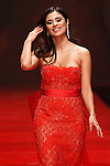 Actress Diane Guerrero walks runway in a red dress by Gustavo Cadile, for the Red Dress Collection 2017 fashion show, for The American Heart Association, presented by Macy's at the Hammerstein Ballroom in New York City on February 9, 2017; during New York Fashion Week Fall 2017.