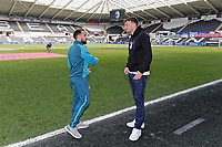 Leon Britton of Swansea City speaks to former Swanse player Michu during the Premier League game between Swansea City v Chelsea at the Liberty Stadium, Swansea, Wales, UK. Saturday 28 April 2018