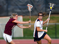 Brittany Kalkstein (17) of Virginia tries to get past Joanna Kiser (20) of Virginia Tech during the first round of the ACC Women's Lacrosse Championship in College Park, MD.  Virginia defeated Virginia Tech, 18-6.