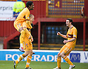 MOTHERWELL'S HENRIK OJAMAA CELEBRATES WITH OMAR DALEY AND JAMIE MURPHY AFTER HE SCORES MOTHERWELL'S SECOND GOAL