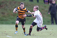 RBAI vs R S ARMAGH | Saturday 21st February 2015<br /> <br /> Michael Lowry gets away from Ross Finlay during 2015 Ulster Schools Cup Quarter-Final between RBAI and Royal School Armagh at Osborne Park, Belfast, Northern Ireland.<br /> <br /> Picture credit: John Dickson / DICKSONDIGITAL