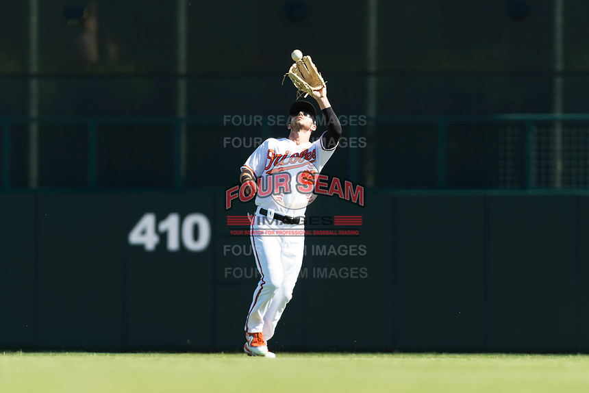 Glendale Desert Dogs center fielder Ryan McKenna (82), of the Baltimore Orioles organization, prepares to catch a fly ball during an Arizona Fall League game against the Mesa Solar Sox at Camelback Ranch on October 15, 2018 in Glendale, Arizona. Mesa defeated Glendale 8-0. (Zachary Lucy/Four Seam Images)