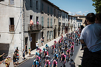 peloton rolling through town<br /> <br /> Stage 13 from Nîmes to Carcassonne (219.9km)<br /> 108th Tour de France 2021 (2.UWT)<br /> <br /> ©kramon