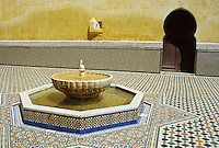 Meknes, Morocco.  Mausoleum of Moulay Ismail.  Courtyard, Sun Dial, Horseshoe Arch Doorway, Fountain.