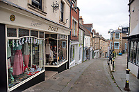 BNPS.co.uk (01202) 558833<br /> Pic: ZacharyCulpin/BNPS<br /> <br /> Pictured: Frome Town centre<br /> <br /> At 6ft 9in tall, dressed all in black, with a big beard and wearing wayfarer shades, Andy Wrintmore does not look like your typical mayor.<br /> <br /> But the 29-year-old hardcore punk rock drummer is a big hit with old and young constituents in his hometown of Frome, Somerset.<br /> <br /> Andy, a member of punk band SickOnes, was elected to the town council by a landslide vote in 2019 and chosen to become the town's mayor in May this year.<br /> <br /> He has earned the moniker the 'punk rock mayor of Frome' and has even been interviewed by Kerrang magazine about his new career - cutting ribbons and meeting local community groups.