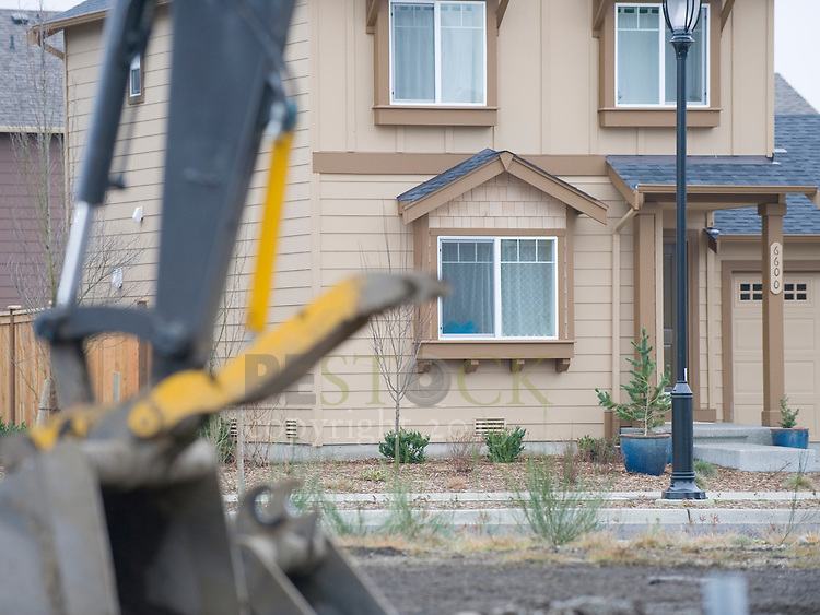 Tan Home Across Street from Construction