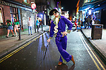 © Joel Goodman - 07973 332324 . 26/12/2017. Wigan, UK. A pimp. Revellers in Wigan enjoy Boxing Day drinks and clubbing in Wigan Wallgate . In recent years a tradition has been established in which people go out wearing fancy-dress costumes on Boxing Day night . Photo credit : Joel Goodman