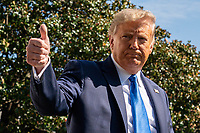 United States President Donald J. Trump gestures as he walks to Marine One on the South Lawn of the White House on Thursday, October 15, 2020. Trump will deliver remarks at a Fundraising Committee Reception in Doral, Florida and participate in a Live NBC News Town Hall Event.    <br /> Credit: Ken Cedeno / Pool via CNP /MediaPunch