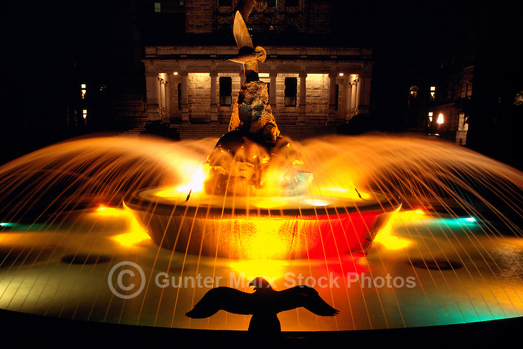 Victoria, BC, Vancouver Island, British Columbia, Canada - Fountain at Rear of BC Parliament Buildings illuminated at Night