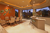 Wet bar and dining room in modern home