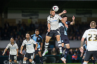 Shaun Hutchinson of Fulham rises to win the ball in the air during the Capital One Cup match between Wycombe Wanderers and Fulham at Adams Park, High Wycombe, England on 11 August 2015. Photo by Andy Rowland.