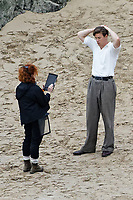 Pictured: Will Poulter. Friday 18 June 2021<br /> Re: Film set with a scene being filmed with Hugh Laurie as a director at Three Cliffs Bay in the Gower Peninsula, Wales, UK.