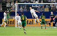 CARSON, CA - OCTOBER 07: Daniel Steres #5 of Los Angeles Galaxy heads a ball during a game between Portland Timbers and Los Angeles Galaxy at Dignity Heath Sports Park on October 07, 2020 in Carson, California.