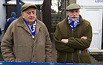Glossop North End 0 Barnoldswick Town 1, 19/02/2011. Surrey Street, North West Counties League Premier Division. Two elderly Glossop North End supporters waiting for the teams to come out  before their club's game with Barnoldswick Town in the Vodkat North West Counties League premier division at the Surrey Street ground. The visitors won the match by one goal to nil watched by a crowd of 203 spectators. Glossop North End celebrated their 125th anniversary in 2011 and were once members of the Football League in England, spending one season in the top division in 1899-00. Photo by Colin McPherson.