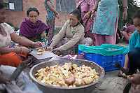 People cook food in a temporary shelter as their houses were damaged at Bhaktapur, near Kathmandu, Nepal. May 03, 2015